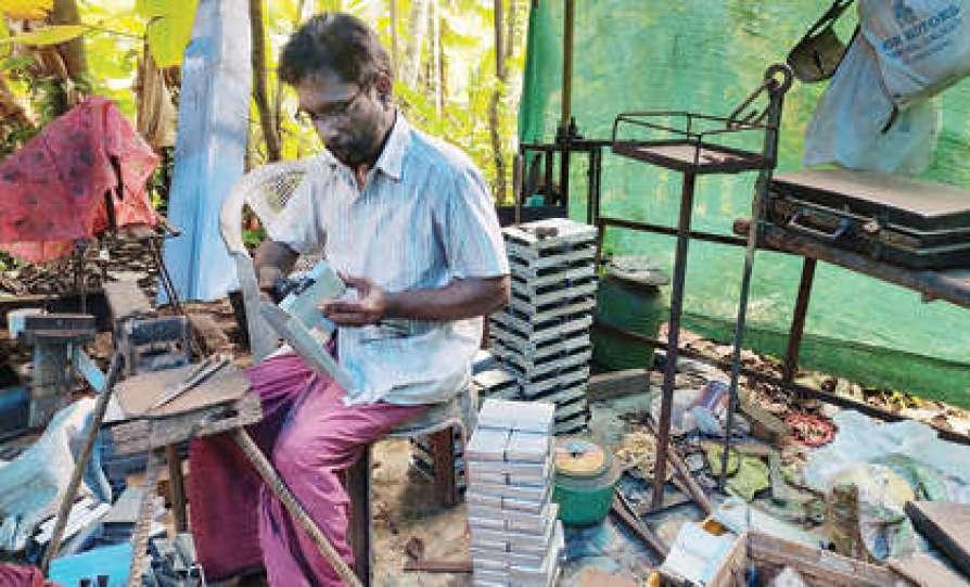 ramakrishnan with his arecanut peeling machine